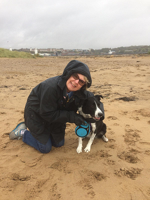 Brody black and white dog at the beach north east windy dog boarding barking mad sue seward