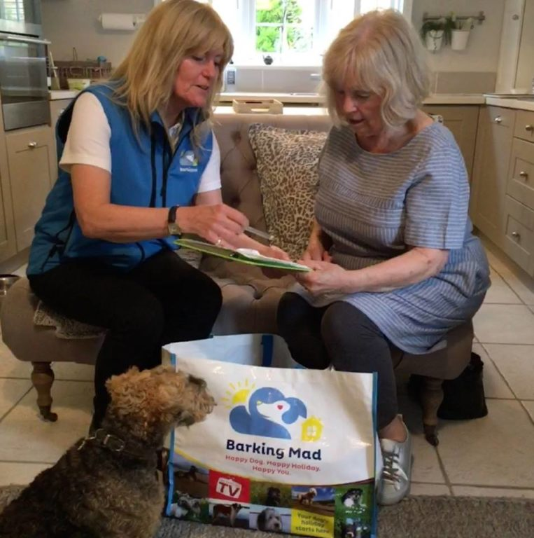 Jeannie Carrying Out A Registration With A New Customer Barking Mad Oxfordshire dog sitting home boarding holiday